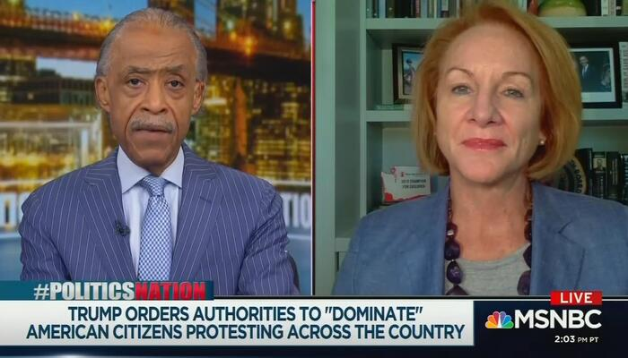 Al Sharpton and Jenny Durkan