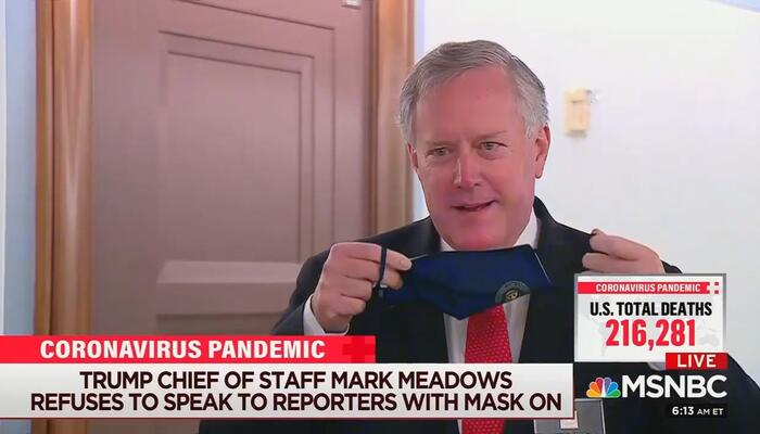 Mark Meadows removes his mask.