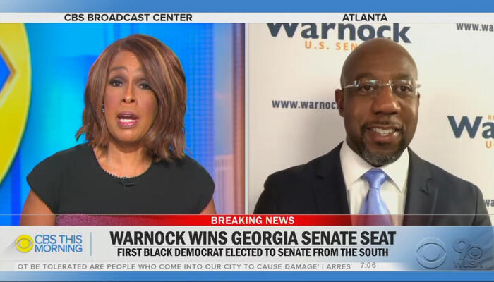 Gayle King and Raphael Warnock