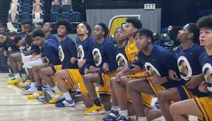 East Tenn. State basketball team kneeling