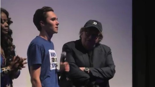 Image result for images of david hogg with michael moore