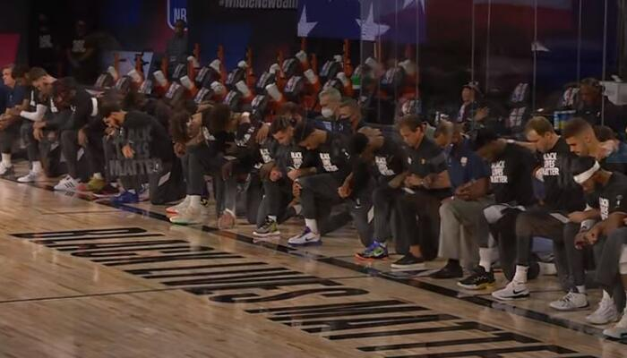 NBA players kneeling
