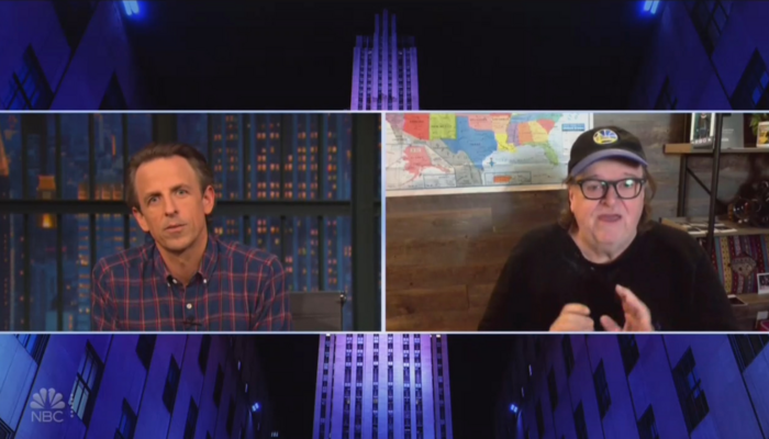 Seth Meyers and Michael Moore